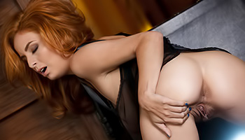Stacked redhead displays her spread vagina