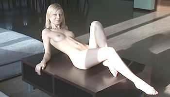 Delicate blonde generously displays her sweet figure