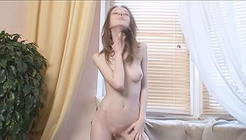 Petite and skinny babe shows her boobs