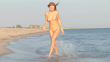 Redhead babe at the beach having fun