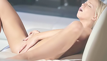 Aroused blonde girl pleases herself