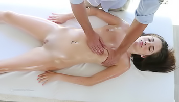Nude brunette likes a full body massage