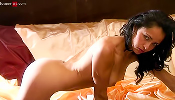 Raven haired seductress knows how to pose