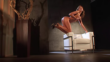 Enticing honey masturbates in a darkened room