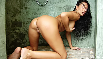 Soaking wet brunette plays in the shower