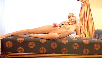 Angelic blonde poses for a cameraman nude