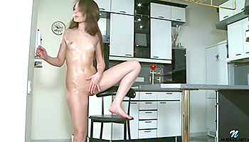 Oiled cuttie ravages herself with rubber