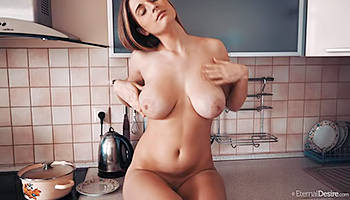 Busty babe poses instead of making dinner