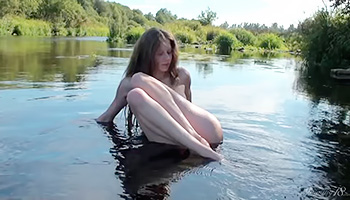 Long haired Russian beauty poses outdoors
