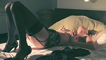 Dreamy blonde in lingerie masturbates wildly