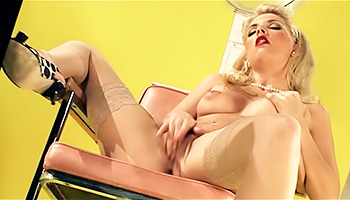 Retro blonde fingers her pussy