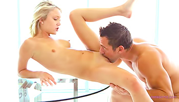 Lusty blonde gets nailed on table