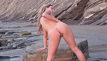 Big ass blonde poses on beach