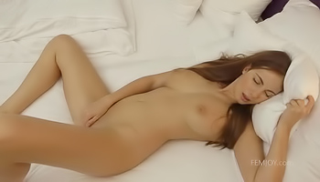 Sweet girl is rubbing her pussy